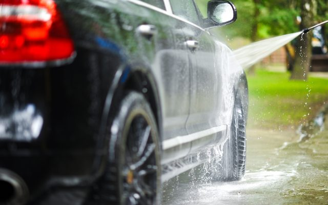 Car Washing on Back Yard. Transportation Photo Collection.